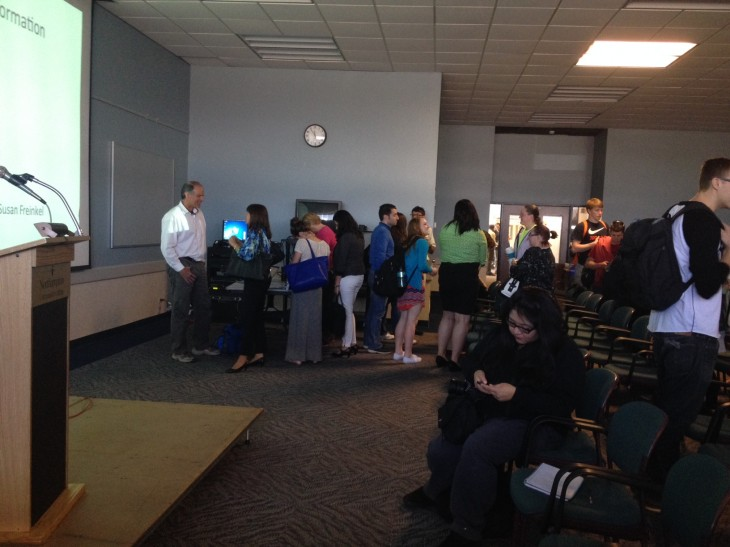 Waterman speaks with attendees of his April 21 lecture on the reality of pollution in our oceans