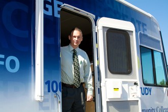 Jim McCarthy shows The Commuter inside NCC's new RV.